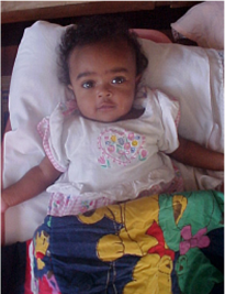 African baby lying in bed