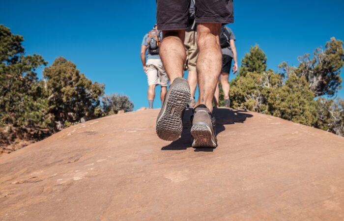 Hikers walking on rocks