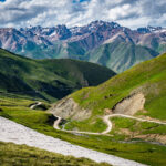 Winding footpath through green mountains