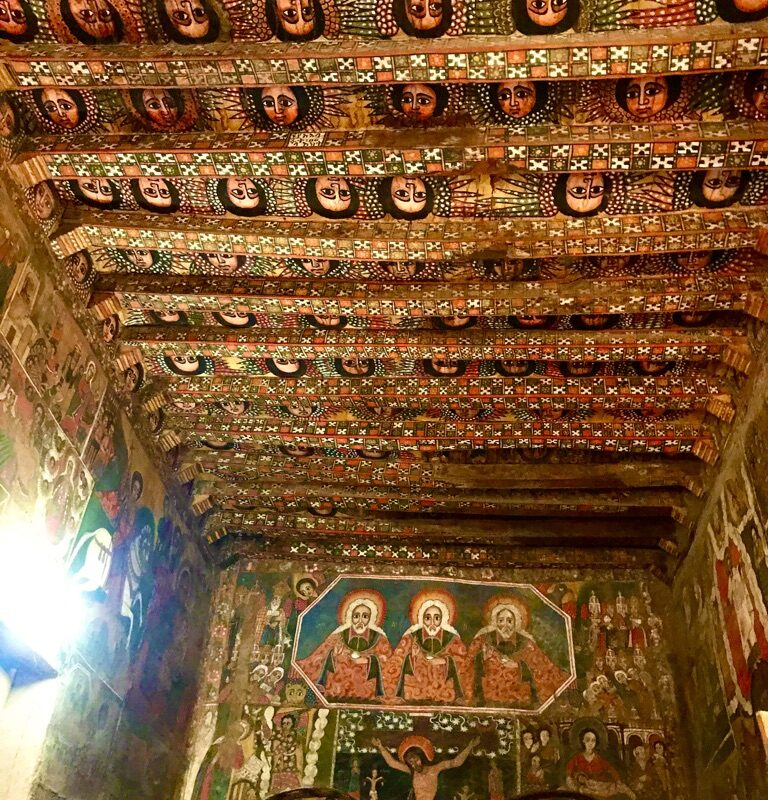 Brightly painted walls and ceiling in an old church